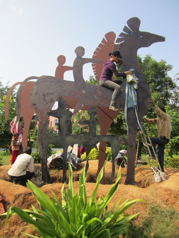 "Chinese sculptor Zhang Yaxi and assistants working on ""Horses & Riders"""