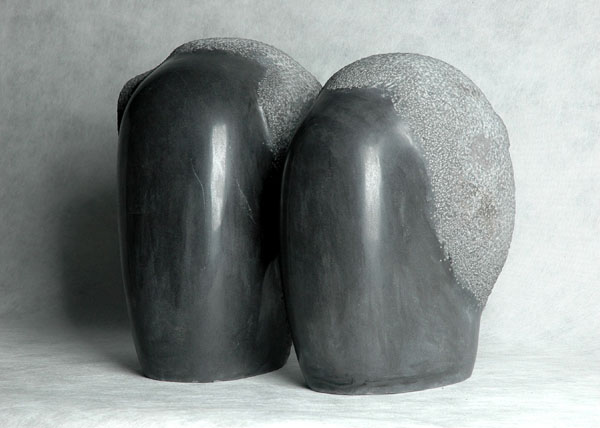 Minimalist Couple - an original black marble carvings by Chinese sculptor Zhang Yaxi - a very contemporary Chinese artwork