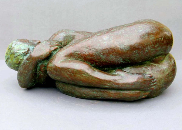 Curled Up - Limited edition bronze sculpture of a nude female - side view of this realistic, figurative sculpture