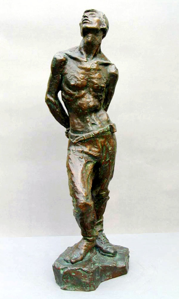 A gallery photograph of the same young male sculpture - lost wax bronze casting of the sculpture