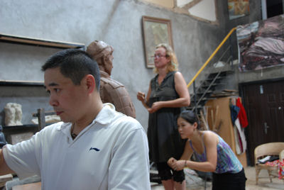 Zhang Yaxi, Shen Xiaonan and Laury Dizengremel working on the Terracotta Warriors of Tennis in their Tank Loft Contemporary Arts Center studio, adjacent to the Sichuan Fine Arts Institute in Chongqing