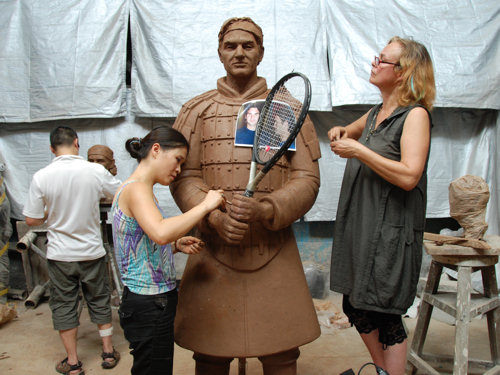 Zhang Yaxi working with fellow sculptors Shen Xiaonan and Laury Dizengremel on the Roger Federer sculpture portrayed as a Tennis Terracotta Warrior in her Tank Loft Contemporary Arts Center studio in Chonqging, Chinq